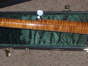 The Artist, Flamed Maple with inlaid Mother-of-Pearl and red abolone.
