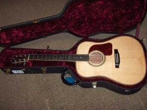 The Doc Watson Signature Model has Flamed Maple binding, Ebony fretboard and bridge, African Mahogany for back and sides, Alaskan Sitka for top-1