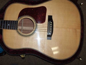 The Doc Watson Signature Model has Flamed Maple binding, Ebony fretboard and bridge, African Mahogany for back and sides, Alaskan Sitka for top-2