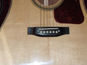 The Doc Watson Signature Model has Flamed Maple binding, Ebony fretboard and bridge, African Mahogany for back and sides, Alaskan Sitka for top-3